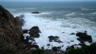 Big sea swells breaking against rocks and cliffs during  a groundswell hitting the coast of Huatulco, Mexico video