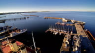 Big ships and small sea vessels docking video