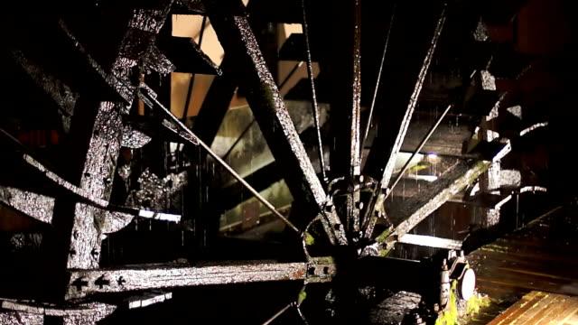 Big steel watemill wheel rotates slowly close up video