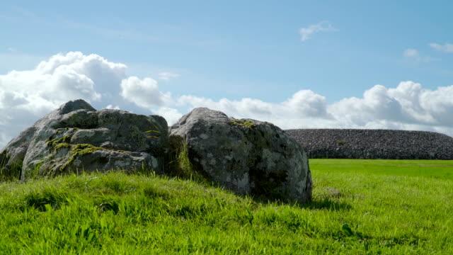 Big stones on the green grassy ground Ireland video