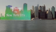 Big transparent Welcome to New York City sign dragging after boat video