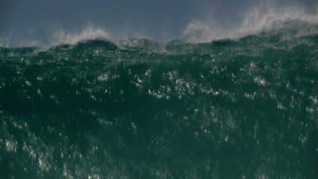 Big wave crashing down, slow pull video