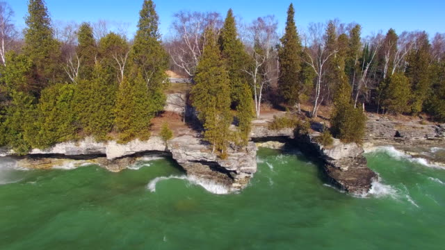 Big waves crash on rocky shores of Cave Point, Wisconsin video
