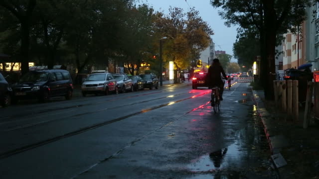 Bike and car on wet pavement video