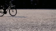 Bike crossing old cobbled square video