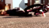 Bike helmet falling on the path after an accident video