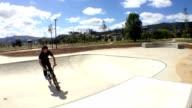 BMX bike stunt in skateboard park video