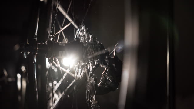 Bike wheel detail in the dark - gear and chain video