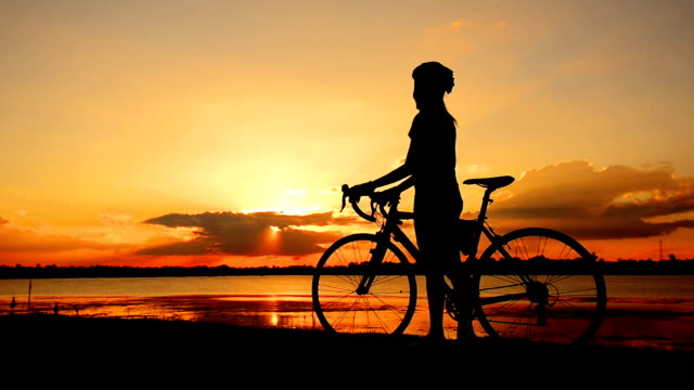Biker at sunset. video