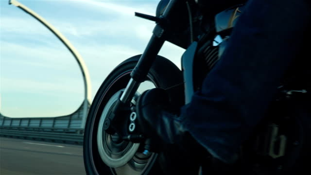 Biker Driving A Motorcycle On Highway video