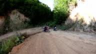 Biker driving motorcycle on off-road video
