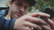 BMX biker hanging around with smartphone video