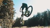 SLO MO MTB biker jumping over the camera video