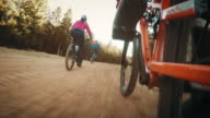 POV Biker pedaling to catch his friends riding in front video