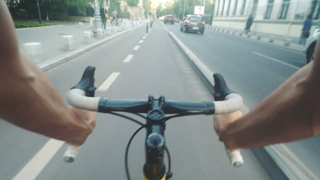 POV Biker riding a bicycle on city streets. video