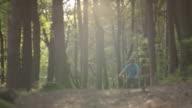 SLOW MOTION: Biker riding downhill bike in the woods video