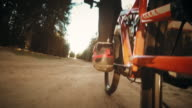 POV of a biker's foot while riding on forest road video