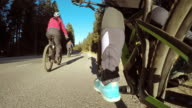 POV Biker's legs pedaling along country road video