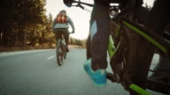 POV from bikers legs pedaling on country road video