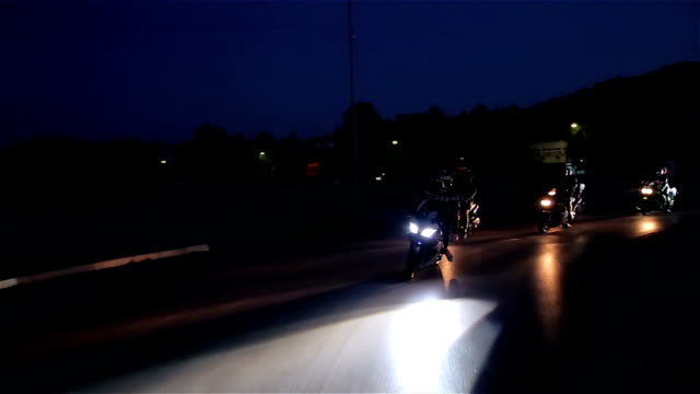 Bikers race at night video