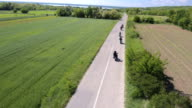 bikers riding on the rural road video