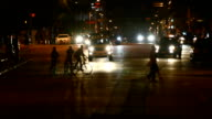 Bikes and pedestrians crossing at night video