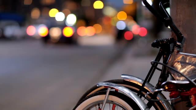 Bikes Lean Near Street Corner as Cars Drive By video