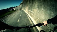 Biking on bicycle lane by the Tiber River in Rome video