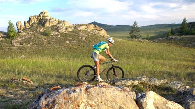 biking woman cycling at sunset video
