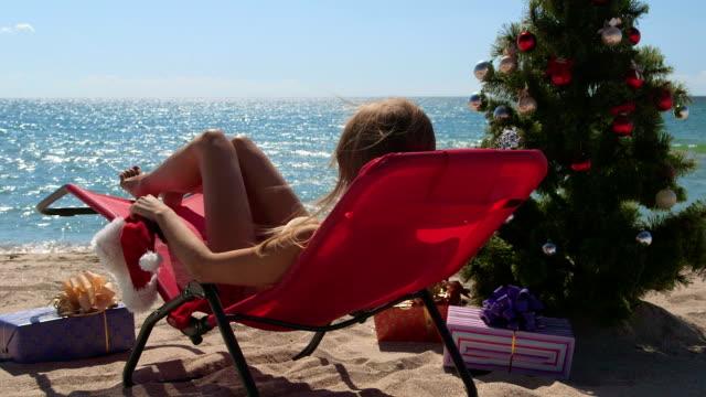 Bikini woman celebrate Christmas on tropical beach video
