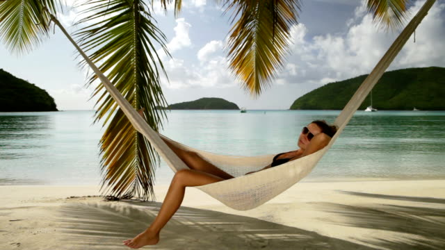 bikini woman napping in a hammock at the Caribbean beach video