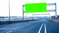 Billboard chromakey on the highway. timelapse video