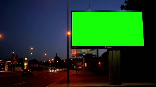 A Billboard with a Green Screen on a Busy Night Street video