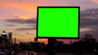 A Billboard with a Green Screen on a Busy Street. video