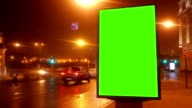 A Billboard with a Green Screen on a Streets video
