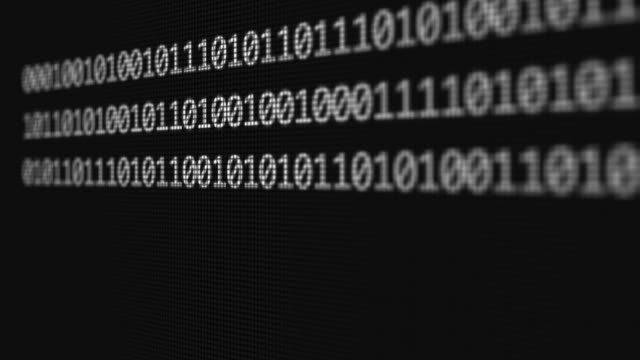 Binary code typing on computer screen video