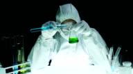 Biochemist Examining Beaker Test Tube video