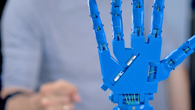 A bionic arm in close view works showing its hinges. video