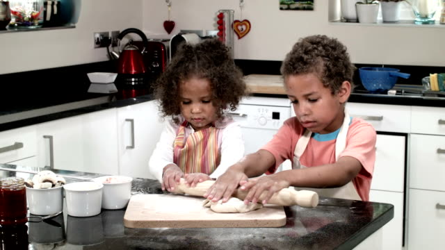 HD: Biracial Boy and Girl Rolling Dough video