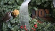 bird on a Christmas wreath with joy word video