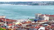 Bird view of Lisboa downtown. Baixa rooftops with the Commerce square and Tagus river at the background. Portugal timelapse video