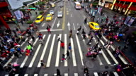 Bird view of the pedestrians go crossing the street in downtown, Taipei, China video