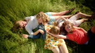 Birds Eye View Of Girls Laying In Field, They Tickle Each Other And Play With Each Other's Hair video