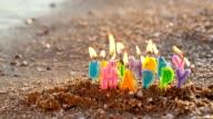 Birthday candles burning on a seashore video
