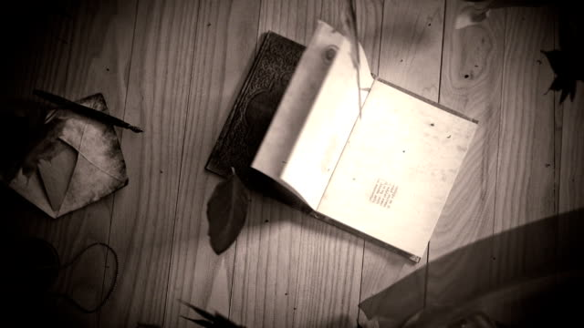 black an white Animation of a book opening, with winding leafs and curtains conceptual background video