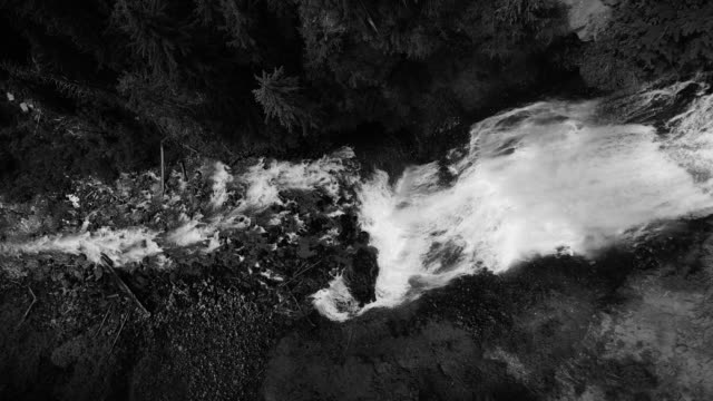 Black and White Aerial Flying Up Waterfall Slow Motion Flowing Over Cliff Edge video