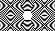 Black and white circles shifting to warped hexagon video