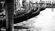 Black and white footage of Venecian gondolas rocking on waves video