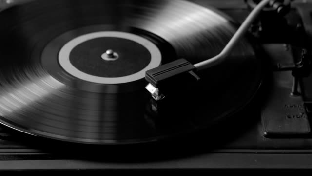 Black and white shot of a record player playing vinyl. Retro Vinyl Turntable Stylus video