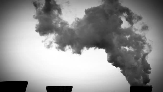 Black and white vignette footage of a chemicals plant's cooler emitting vapour video